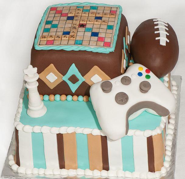 Game theme birthday cake with Scrabble board, Chess King piece, football and XBox 360 Controller.JPG