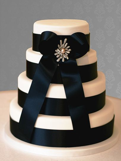 Four Tier Round White Wedding Cake With Black Ribbons And