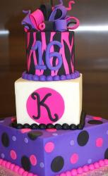 3 tier Sweet 16 birthday cake in pink and purple with bow on top.JPG