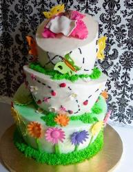 Three tier white topsy-turvy flower and butterflies theme baby shower cake.JPG