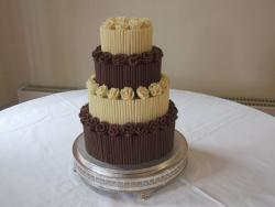 4 tier white and dark chocolate cake.jpg