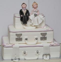 3 tier suitcase theme wedding cake with groom and bride topper.JPG