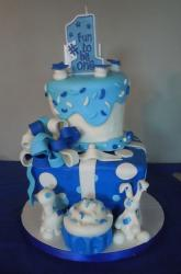 Blue and white first birthday cake wtih ribbon bow and number one topper.JPG