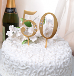 Photo of golden anniversary cake toppers.PNG