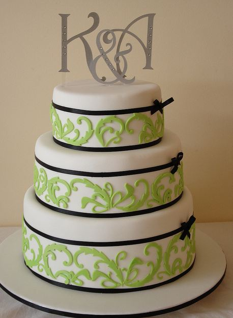 Round 3 Tier White Wedding Cake With Think Black Ribbons And Silver Metallic Monogram TopperJPG