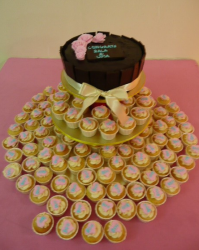 Chocolate engagement cake with full of small cup cakes.PNG