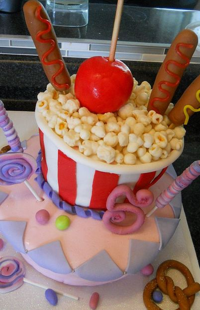 Popcorn and corndogs and candy apple birthday cake.JPG