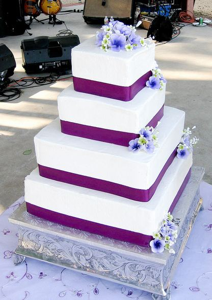 white wedding cake with purple flowers 4 level square white wedding cake with purple bands and 27416