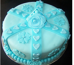 Bright blue engagement cake with floral cake decor pictures.PNG