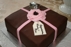 Aquare chocolate engagement cake with pink flower.PNG