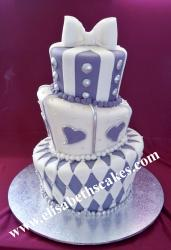 purple and silver  topsy  turvy madhatter  wedding  cake