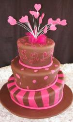 hot pink and chocolatebrown topsy turvy madhatter wedding cake