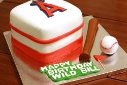 White cubic Los Angeles Angels birthday cake with bat and ball.JPG