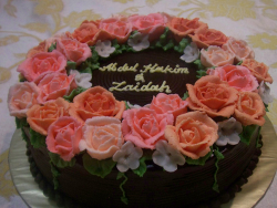 Dark chocolate engagement cake with peach floral with letters.PNG