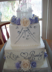 Big two tiers engagement cake with floral cake decor and glass castle cake topper.PNG