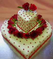 Big heart shape engagement cakes with fresh roses as cake decor.PNG
