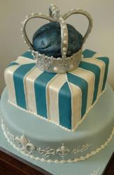 Blue and white cake with crown on top.JPG