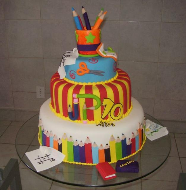 Four tier pencils and school supply theme cake.JPG