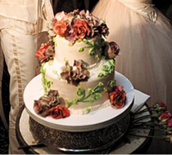 Ellen DeGeneres and Portia de Rossi celebrity wedding cake with roses.PNG