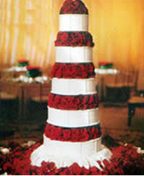 Leann Rimes celebrity romantic wedding cake picture_5 tier wedding with bright red roses.PNG