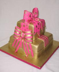 Two tier gold box cake with pink bows.JPG