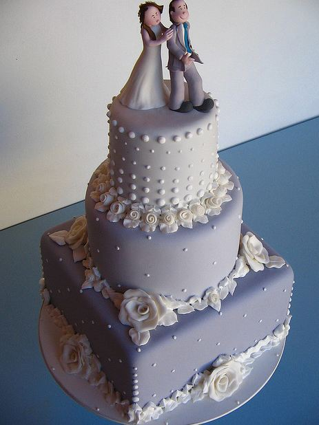 wedding cake lavender and white tri tier lavender wedding cake with white floral desgin 23063