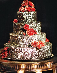 Billy Martin & Linzi Williamson wedding cake with chocolate decor with red roses.PNG
