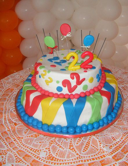 Two Tier Color Ful Round White Cake With Clown Like Colors