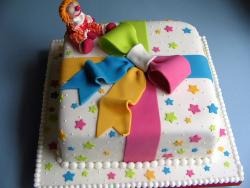 White present box cake with colorful stars and bow and clown.JPG