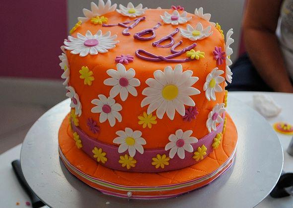Orange Cake With White Flowers Jpg