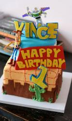 2 tier Toy Stoy theme first birthday cake.JPG