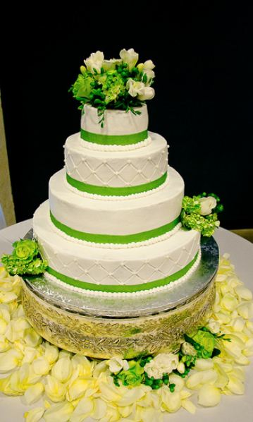 Four Tier Round White Wedding Cake With Green Bands And Flowers JPG