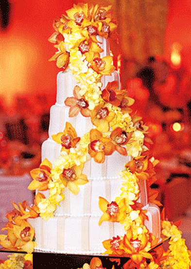 Roselyn Sanchez wedding cake with fresh flowers in bright yellow and orange_Beverly Hills wedding cakes picture.PNG