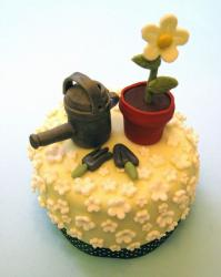 Garden theme cake with watering can and flower in pot.JPG