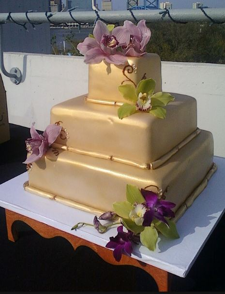 Three Tier Square Gold Wedding Cake With Faux Flowers JPG