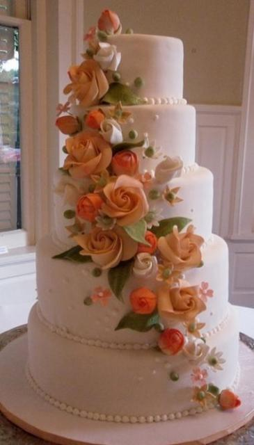 Five tier round white wedding cake with pink and white roses.JPG