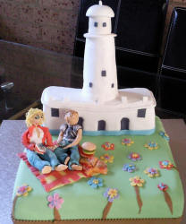 Georgia theme engagement cake with a couple picnic at a park.PNG
