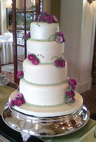 4 tier wedding cake with red roses 4 tier white wedding cake with magenta and pink 10424