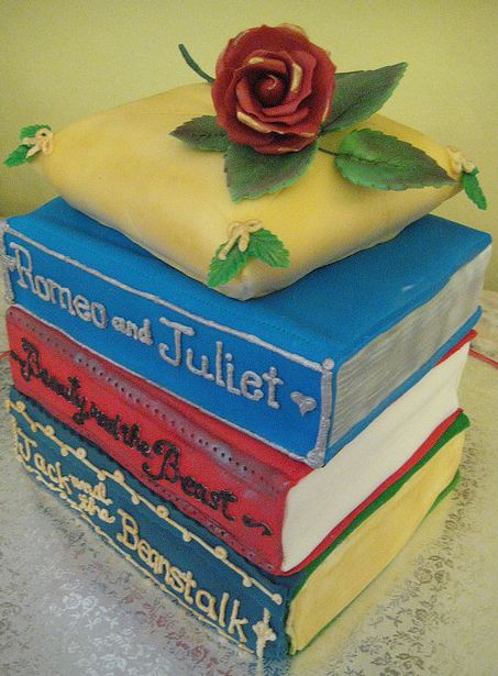 Classic Book Theme Four Tier Cake With Red Rose On Top Jpg
