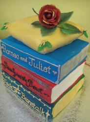 Classic book theme four tier cake with red rose on top.JPG