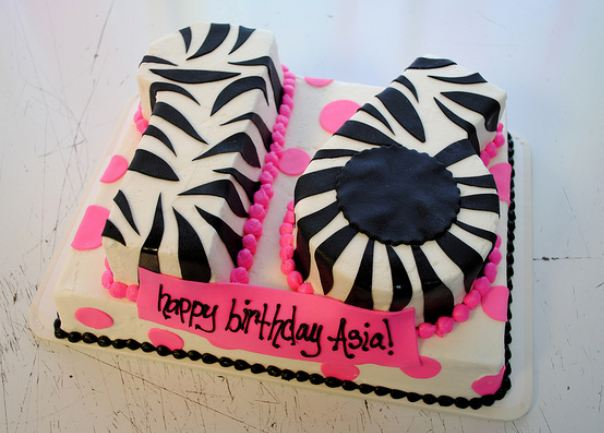 Sweet 16 birthday cake in the shape of the number 16 and zebra stripes and pink pearls.JPG