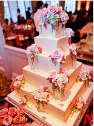 Tia Mowry & Cory Hardrict wedding cake with roses theme.PNG