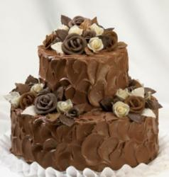 Two tier chocolate birthday cake with roses made of chocolate.JPG