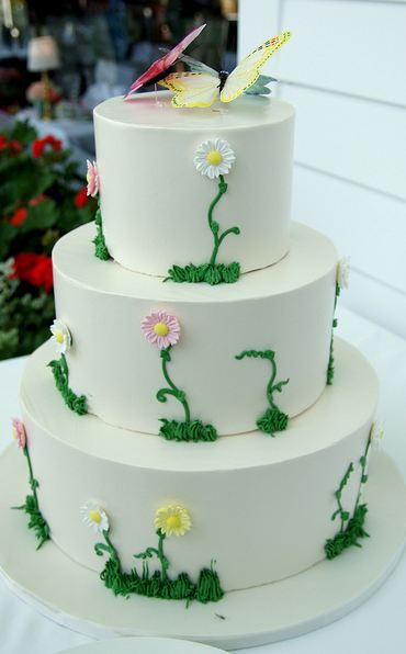 Round white 3 tier wedding cake with 2 butterflies on top.JPG