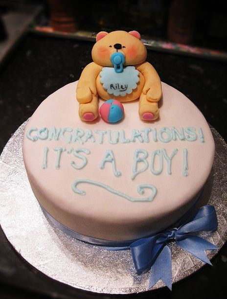Light pink round baby shower cake with chubby baby teddy bear.JPG