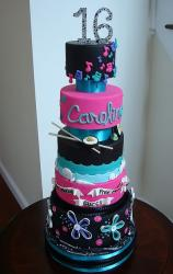 Five tier Sweet 16 birthday cake for girl who likes sushi, music, beach and Gucci.JPG