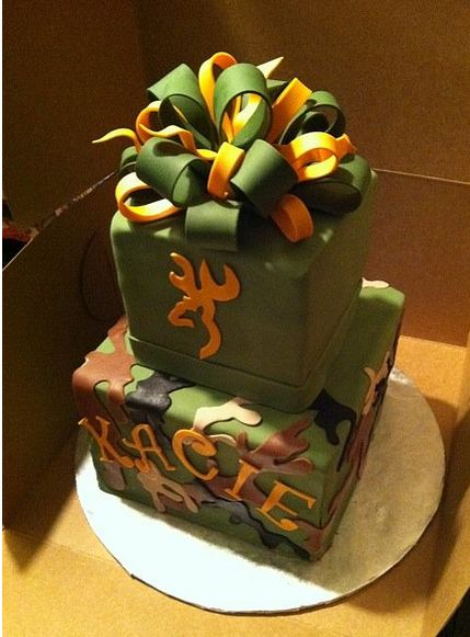 two tier cubic green cake with orange and green bow on top