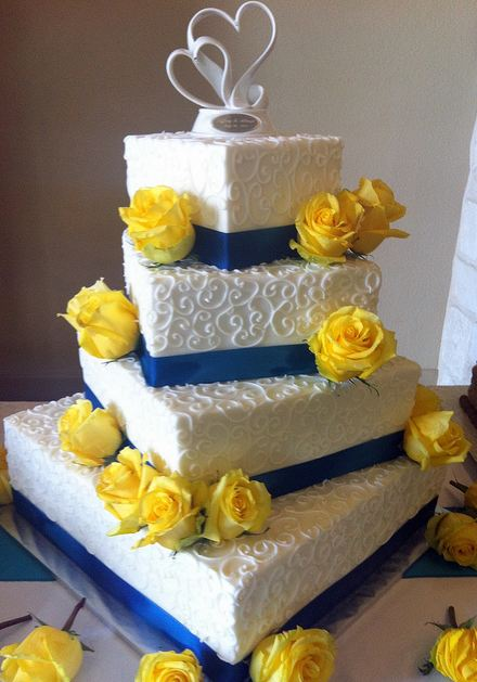 white wedding cake with yellow roses four tier white offset rectangular wedding cake with blue 27426
