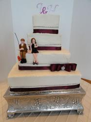 Four tier white square wedding cake with bride and groom fishing and crystal monogram toppers.JPG