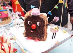 Chocolate toast cake with face and arms and shoes.JPG